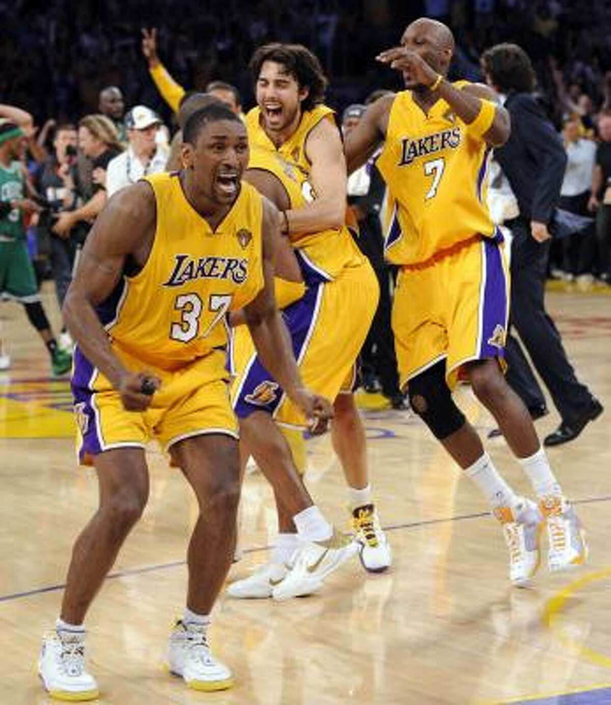 Lakers forward Ron Artest (37), Sasha Vujacic and Lamar Odom, right celebrate after the Lakers beat the Celtics 83-79 in Game 7.