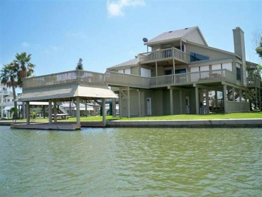 This home in Pirates Cove has 123 feet of waterfront. It's also got three bedrooms and 2.5 bathrooms. It's listed for $545,000. See more details and photos here. Photo: Prudential Gary Greene
