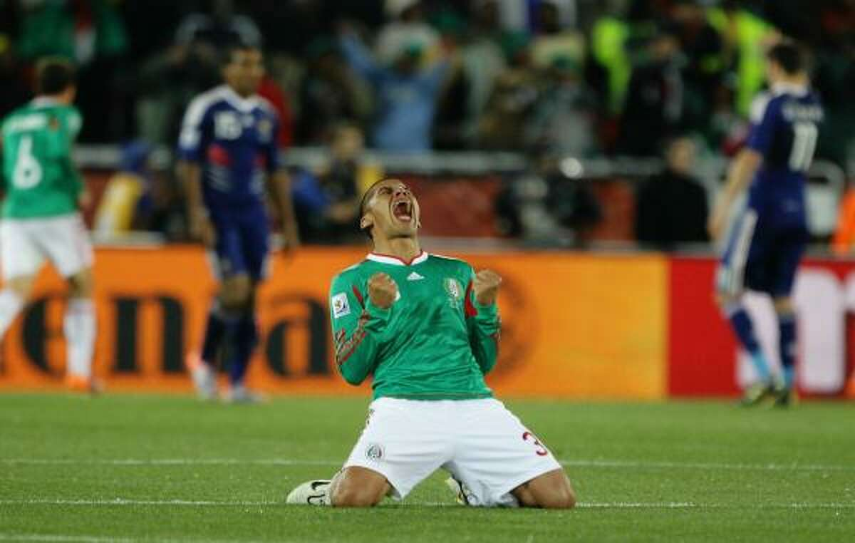 Carlos Salcido of Mexico celebrates the second goal.