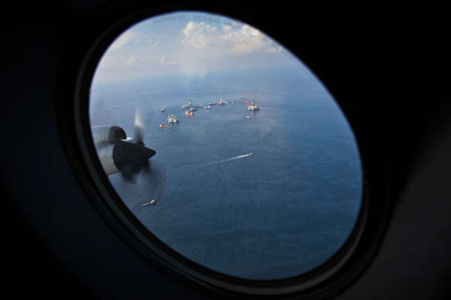 US Customs and Border Protection Air and Marine P-3 aircraft have taken on the roll of controlling the airspace above the US government imposed flight restricted area around the oil spill in the Gulf of Mexico. As hundreds of aircraft, from giant cargo planes to tiny helicopters, fly over the massive oil spill, airborne officers conduct a high-stakes symphony to reduce the chances of midair collisions. Photo: Smiley N. Pool, Chronicle