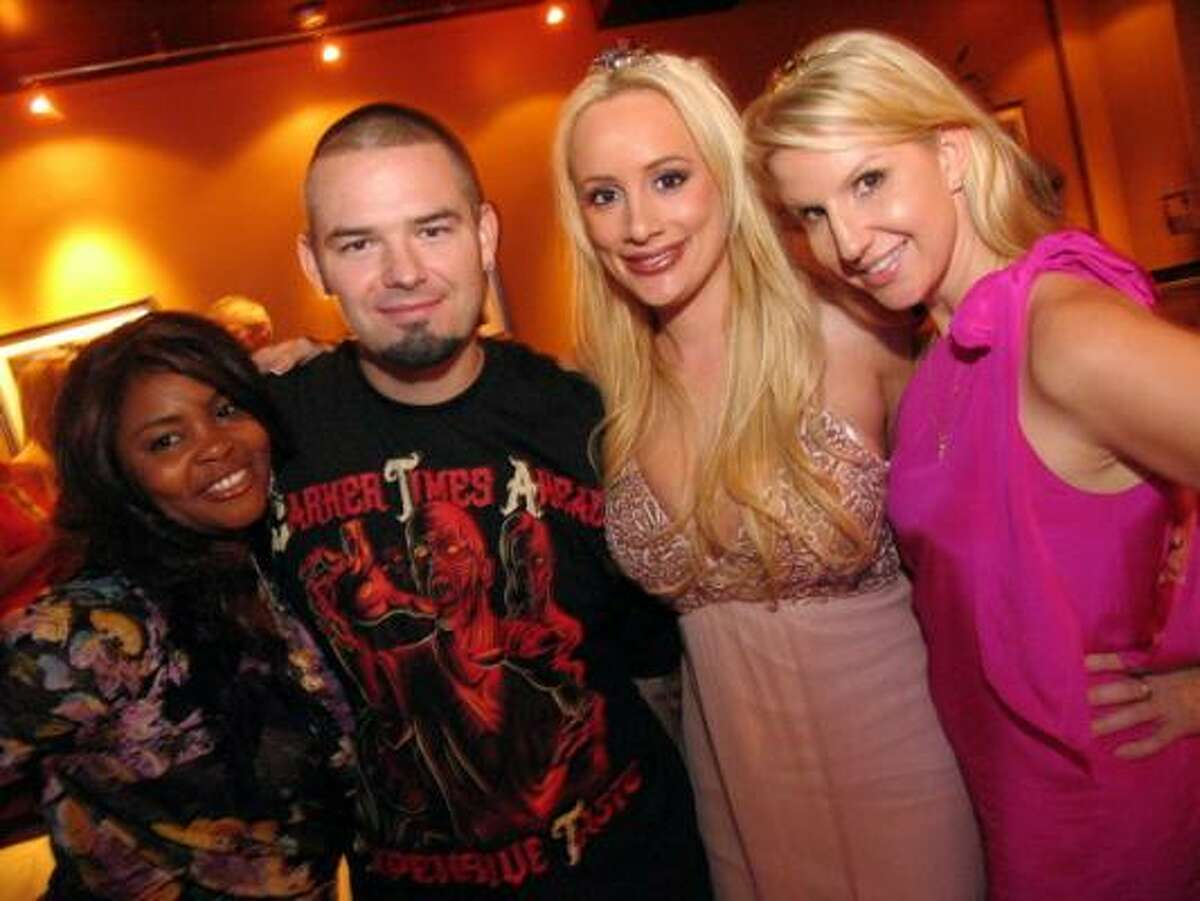Crystal and Paul Wall, with Erica Rose and Lori Freese