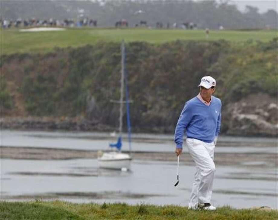 Tom Watson chips up to the 17th green during Wednesday's practice round for the U.S. Open. Photo: Chris Carlson, AP