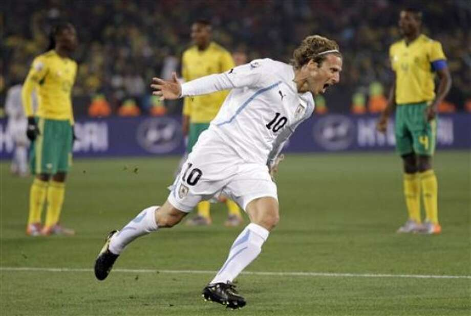URUGUAY 3, SOUTH AFRICA 0Uruguay's Diego Forlan celebrates after scoring his team's first goal at the Loftus Versfeld Stadium in Pretoria. Photo: Matt Dunham, AP