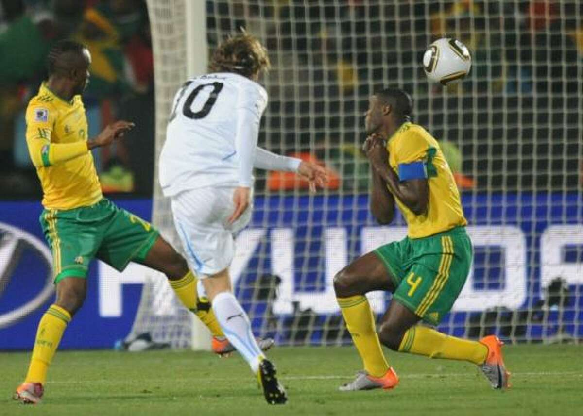 Uruguay's Diego Forlan scores the first goal against South Africa.