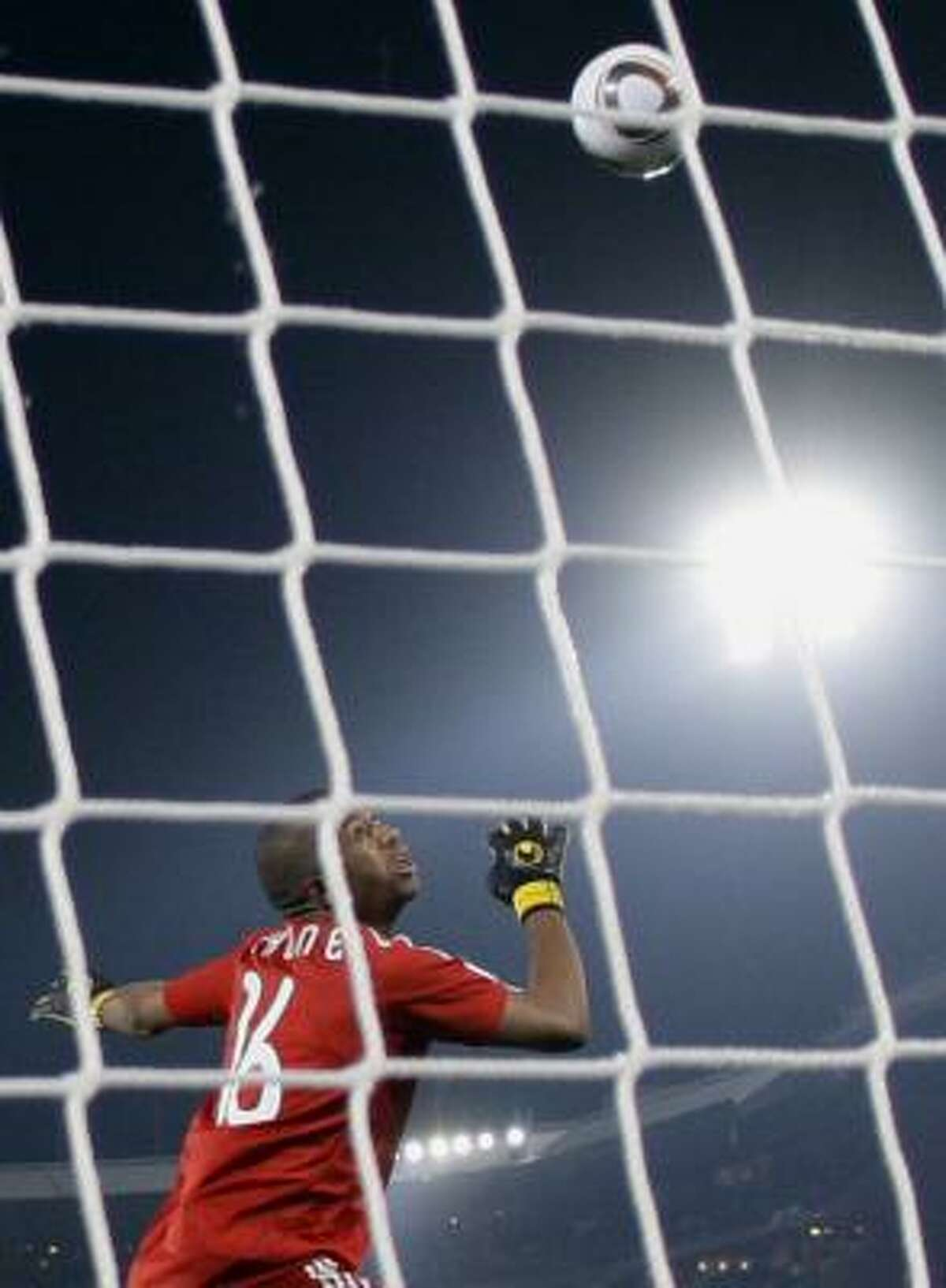 South Africa goalkeeper Itumeleng Khune looks at the ball going into the net on Forlan's first goal.