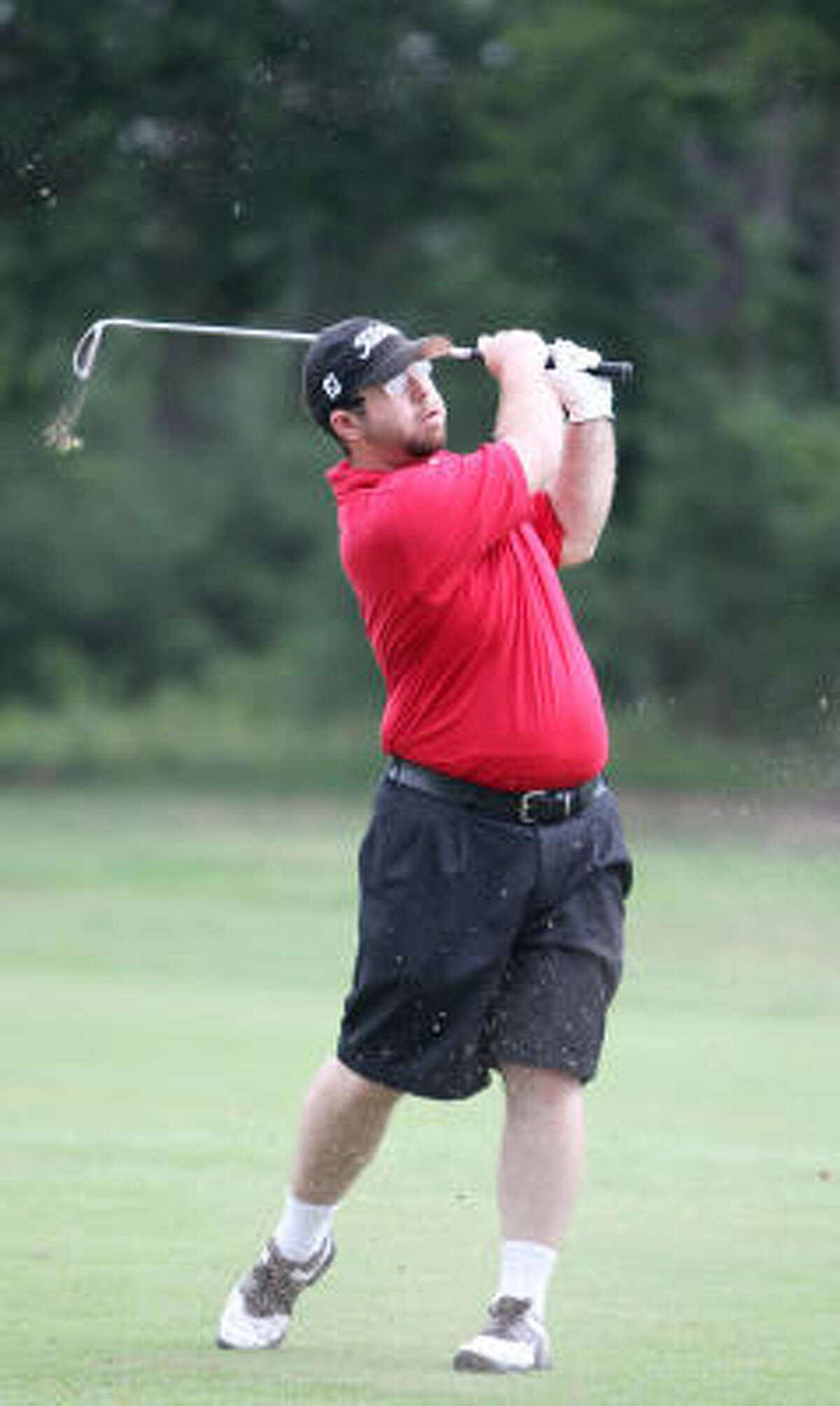 Blair Claghorn of the Spring Panthers Special Olympics golf team watches a ball fly to the green during a June 7 practice. Claghorn is going to be competing in the Special Olympics national tournament in Lincoln, Neb. as a Level 5 golfer.
