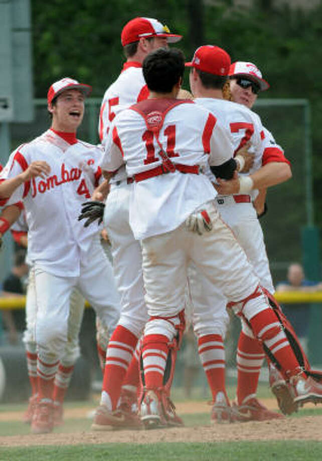 Tomball mobs reliever Doug Sefcik, center, after the final out in Game 3 of the playoff series. Photo: Jerry Baker, For The Chronicle