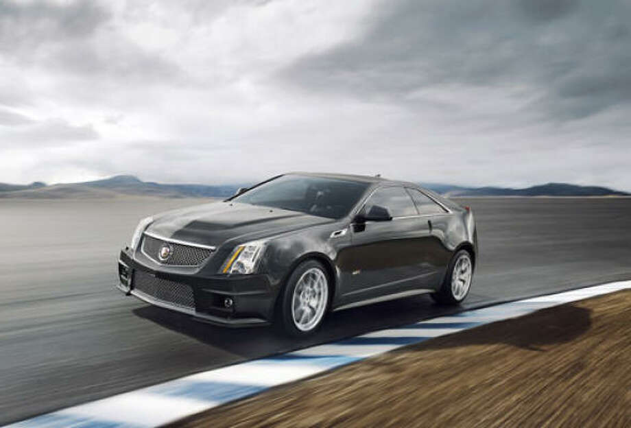 Cadillac CTS-V Coupe – A blend of luxury and performance in a stunning new package allows dad to switch, as the mood strikes, from refined to spirited. Photo: Cadillac