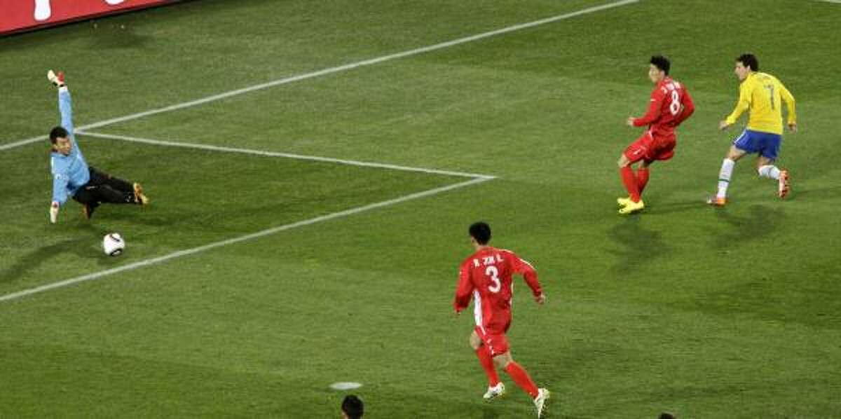 Brazil's Elano, right, scores his team's second goal against North Korea.