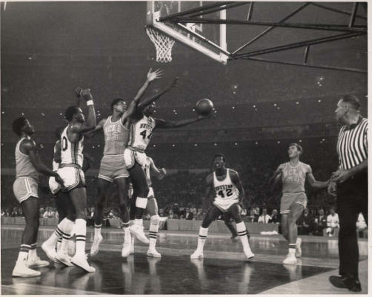 Elvin Hayes, University of Houston's Big E, grabs a rebound away from UCLA's 7-footer, Lew Alcindor, in their Astrodome match on Jan. 20, 1968. The crowd of 52,693 was the largest ever for a collegiate game and saw Hayes account for 39 points, 15 rebounds as the Cougars ended UCLA's 47-game winning streak.