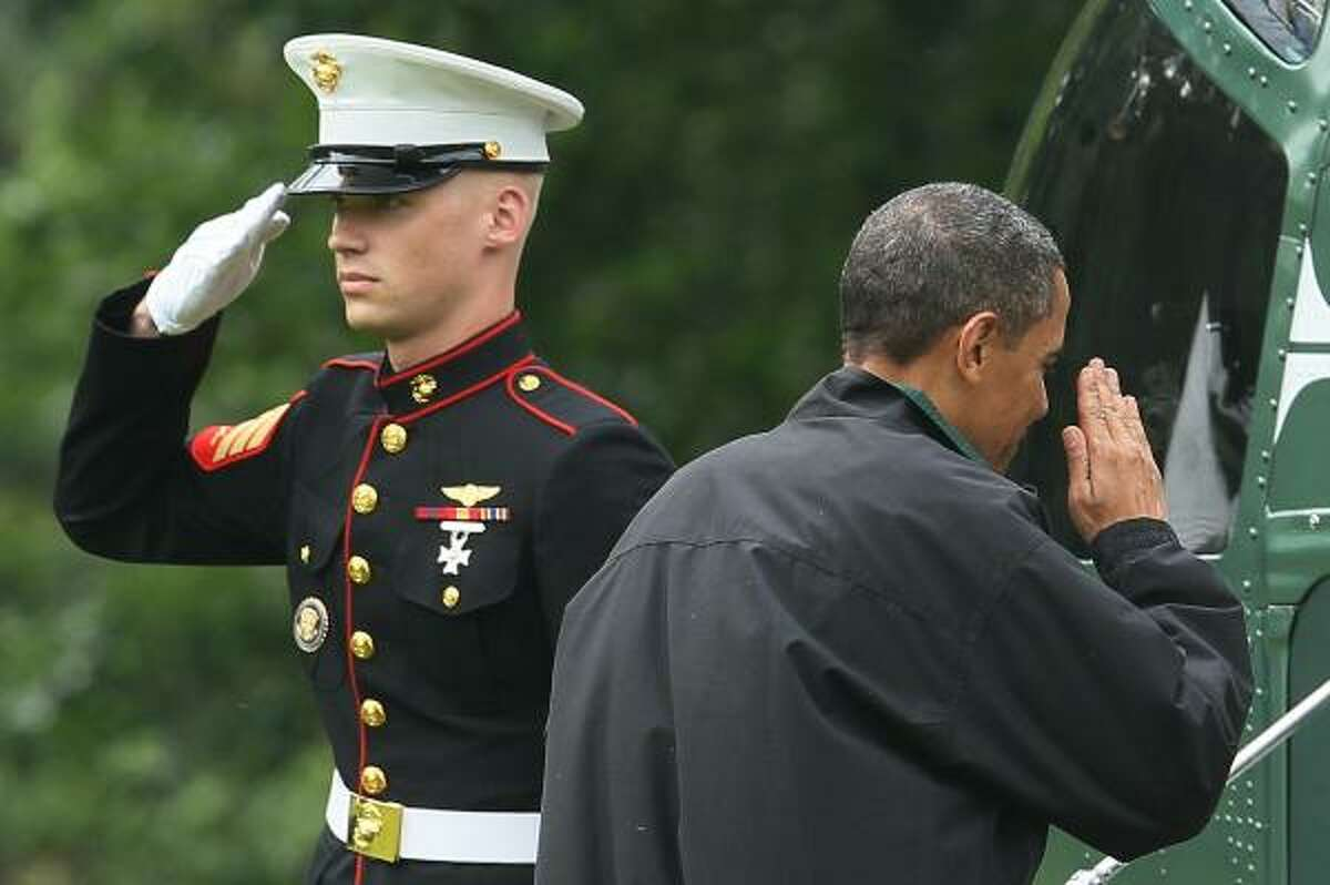 President Obama salutes a U.S. Marine while boarding Marine One to depart the White House on June 14, 2010.
