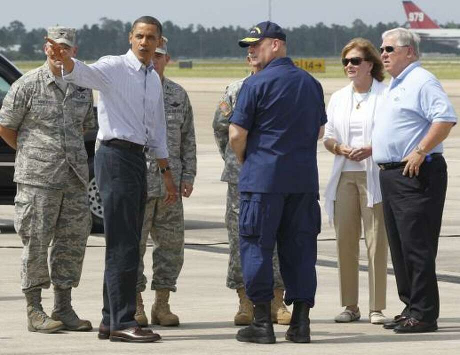 President Obama stands with Mississippi Gov. Haley Barbour, right, Marsha Barbour, and National Incident Commander Adm. Thad Allen, center, after stepping off Air Force One in Gulfport, Miss., on Monday, June 14, 2010, as he visited the region affected by the Deepwater Horizon oil spill. Photo: Charles Dharapak, AP