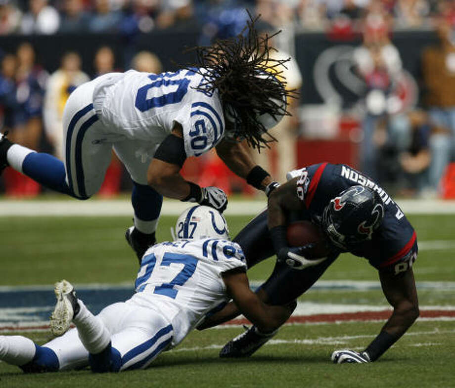 If the Texans are going to reverse the one-sided nature of their rivalry with Indianapolis, then receiver Andre Johnson, being tackled last year by the Colts' Philip Wheeler (50) and Jacob Lacey (27),  will likely have a large say-so. Photo: Johnny Hanson, Chronicle