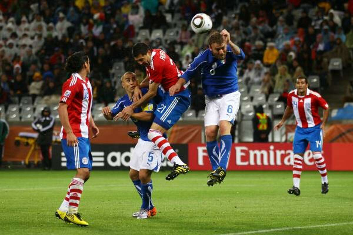 ITALY 1, PARAGUAY 1 Antolin Alcaraz of Paraguay heads the ball for the first score of the game at Green Point Stadium in Cape Town.