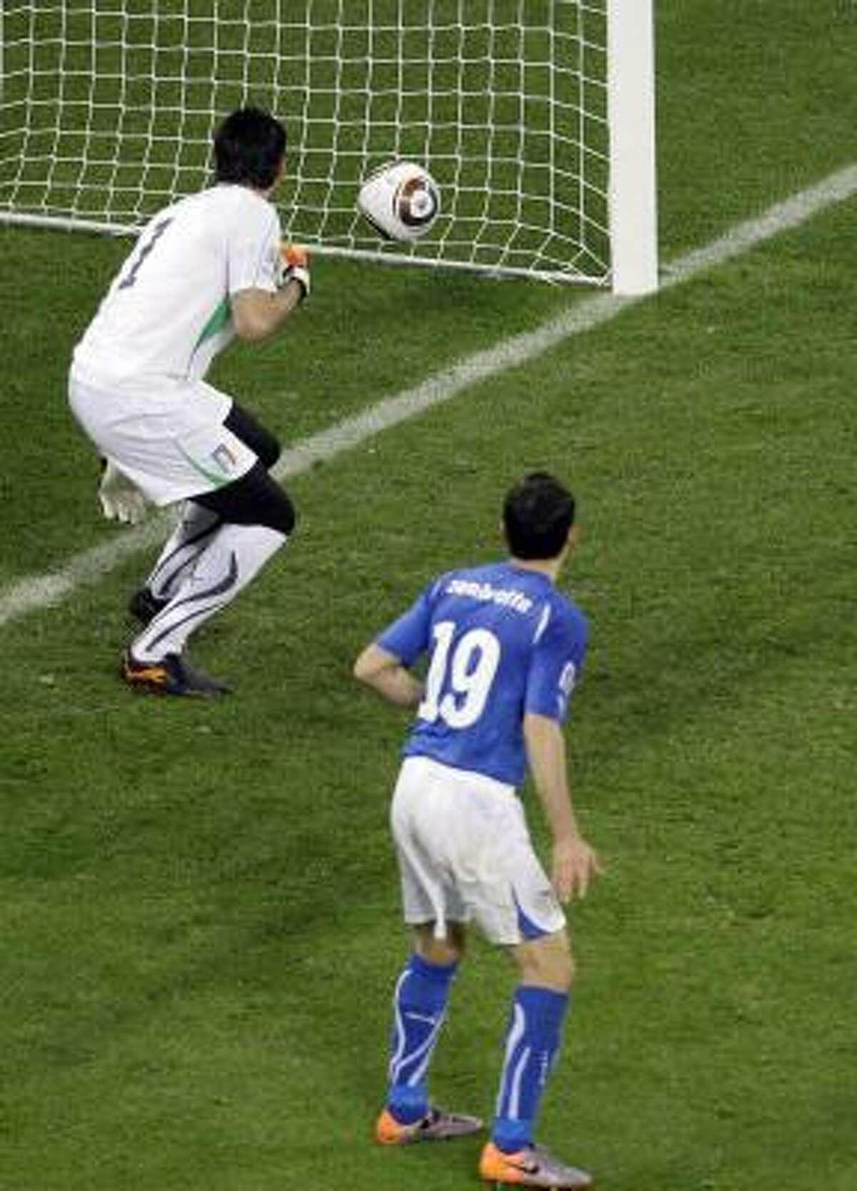 Italy defender Gianluca Zambrotta and goalkeeper Gianluigi Buffon can only watch as Antolin Alcaraz's header sails into the goal.