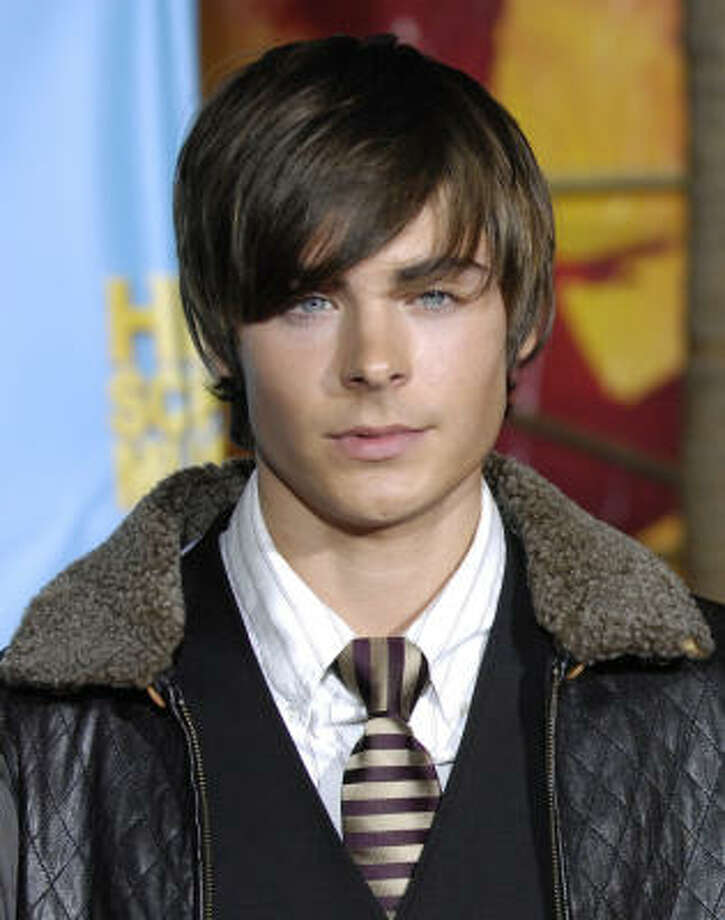 Zac Efron is definitely not the first boy to wear his hair long, but he could be credited with bringing it to the mainstream. Photo: Chris Pizzello, AP