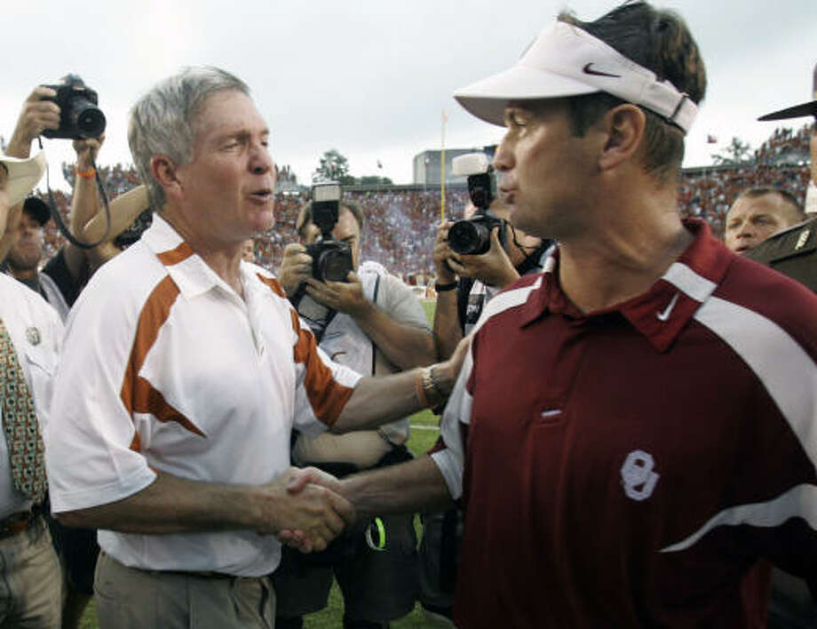 Texas coach Mack Brown, left, and Oklahoma coach Bob Stoops will meet for the 12th time in the Red River rivalry. Photo: L.M. Otero, AP