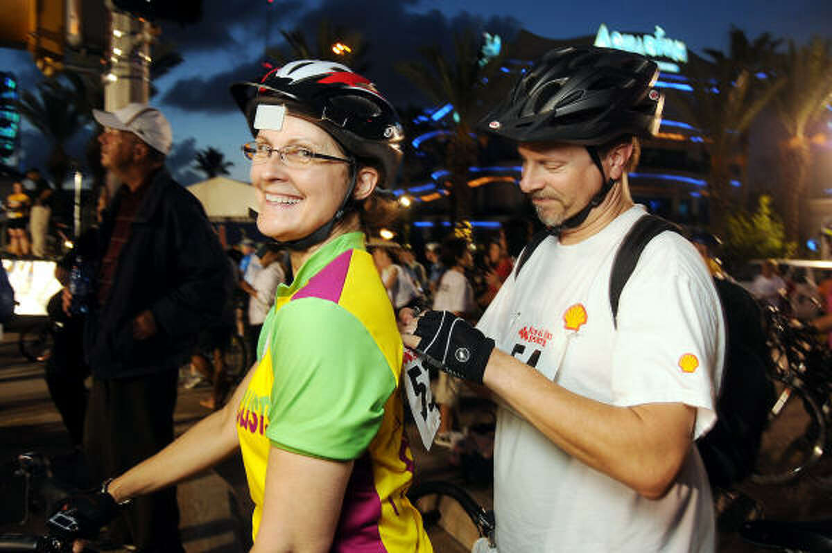 Elinor and Phillip Gregory prepare for the HPD Moonlight Classic Bike Ride.