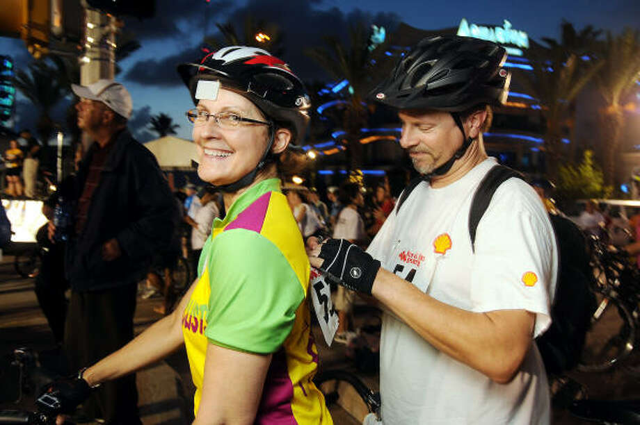 Elinor and Phillip Gregory prepare for the HPD Moonlight Classic Bike Ride. Photo: Dave Rossman, For The Chronicle