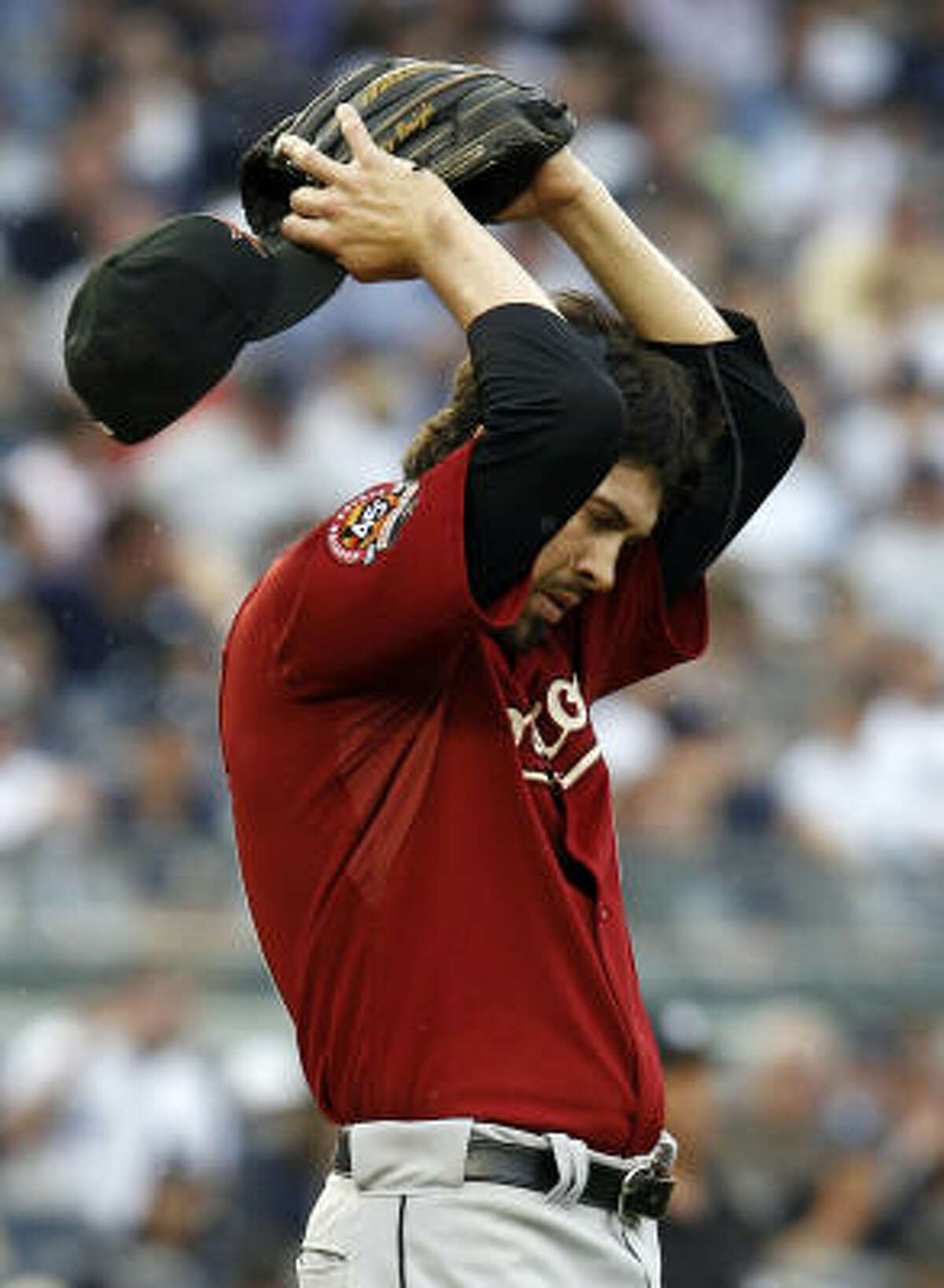 Astros reliever Casey Daigle reacts on the mound after giving up a fifth-inning grand slam to Jorge Posada, the first batter he faced.