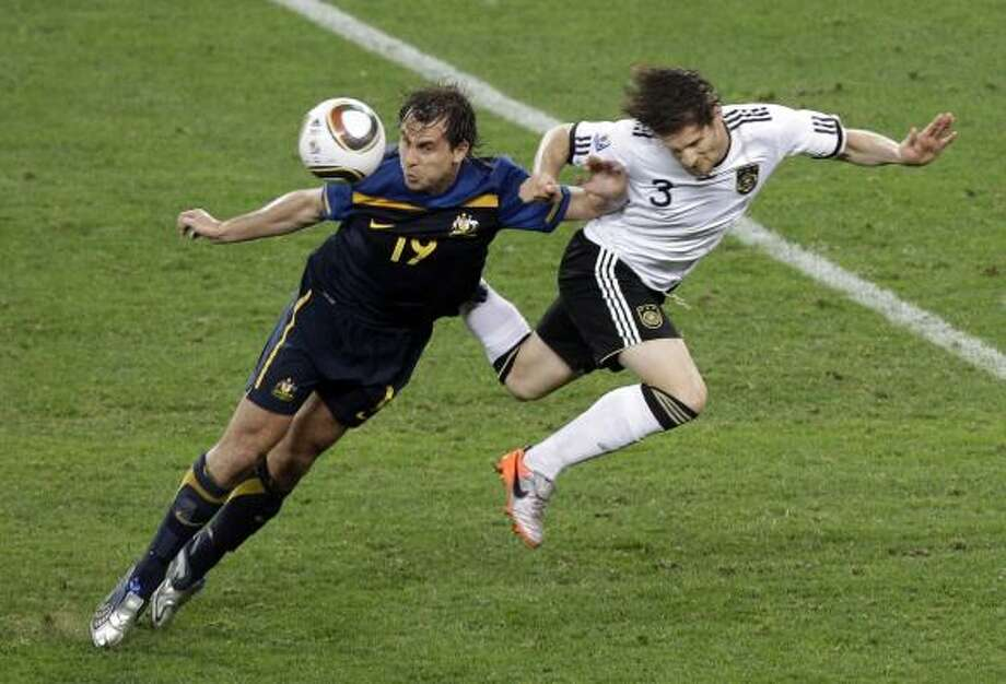 Germany 4, Australia 0Australia's Richard Garcia, left, and Germany's Arne Friedrich fight for the ball. Photo: Rob Griffith, AP