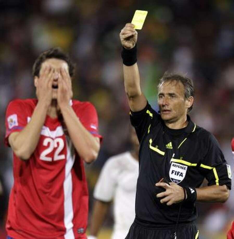 Player: Aleksandar LukovicGame: Serbia vs. GhanaOffense: Held back Ghana striker Asamoah Gyan on the half-way line Photo: Luca Bruno, AP