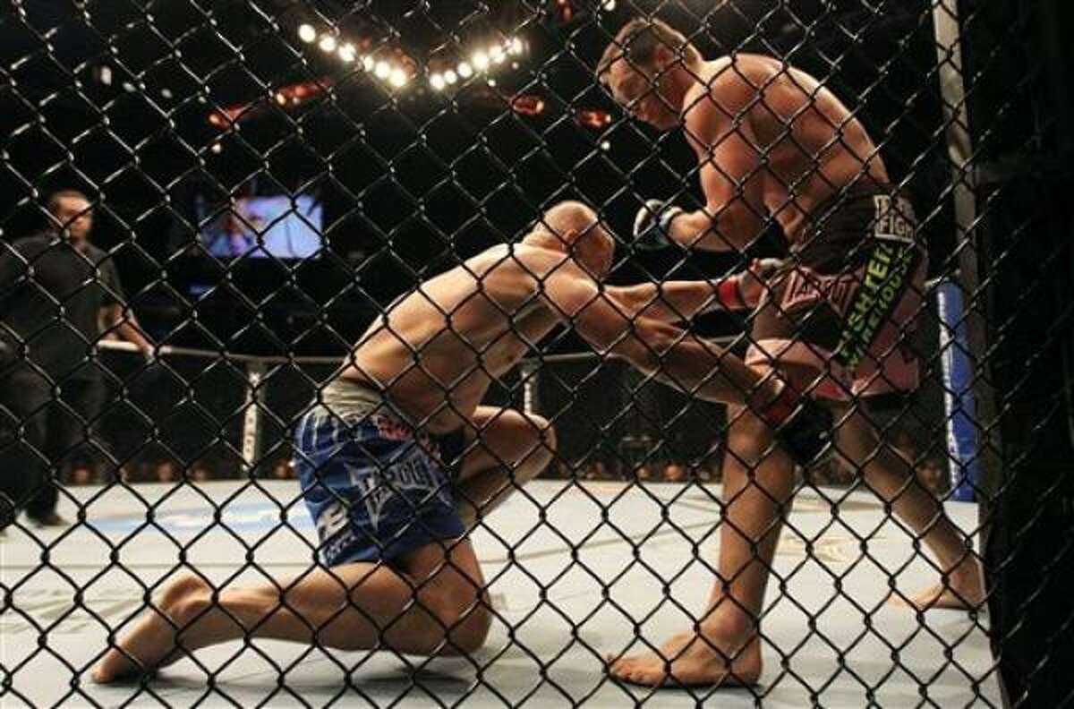 Rich Franklin tries to avoid a takedown by Chuck Liddell.