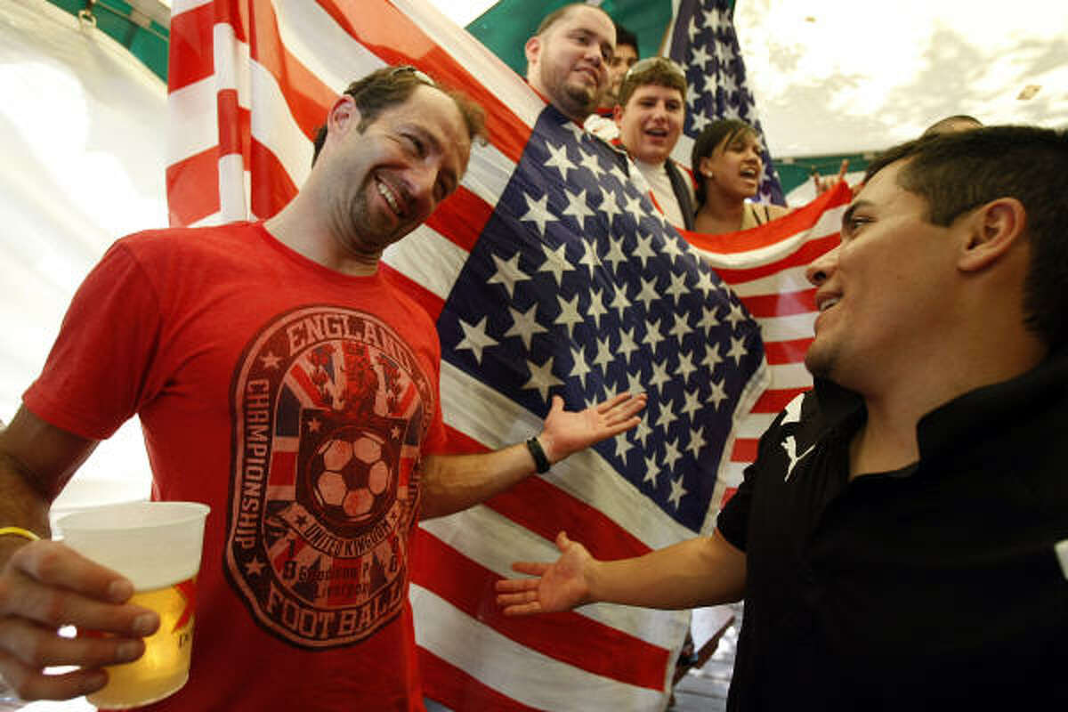 Alex Penny of London, England, who now lives here in Houston, gives a reluctant congratulations to friend, co-worker and U.S. soccer supporter, Ryan Garcia of Houston, as hundreds of U.S. and England fans gathered at Richmond Arms Pub to watch the U.S. and England played to a 1-1 tie in the World Cup.