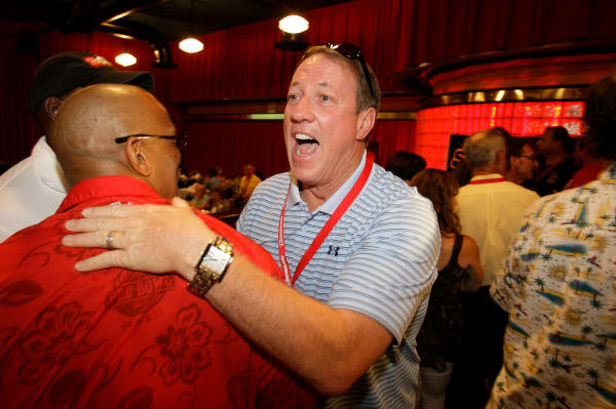 Pro Football Hall of Famer and former Houston Gamblers quarterback Jim Kelly greets former Gamblers teammate Anthony Brock during the 25-year reunion of Gamblers alumni Saturday at Dave and Buster's in Houston. The Gamblers played in 1984 and 1985, twice advancing to the USFL playoffs with a combined record of 23-15.