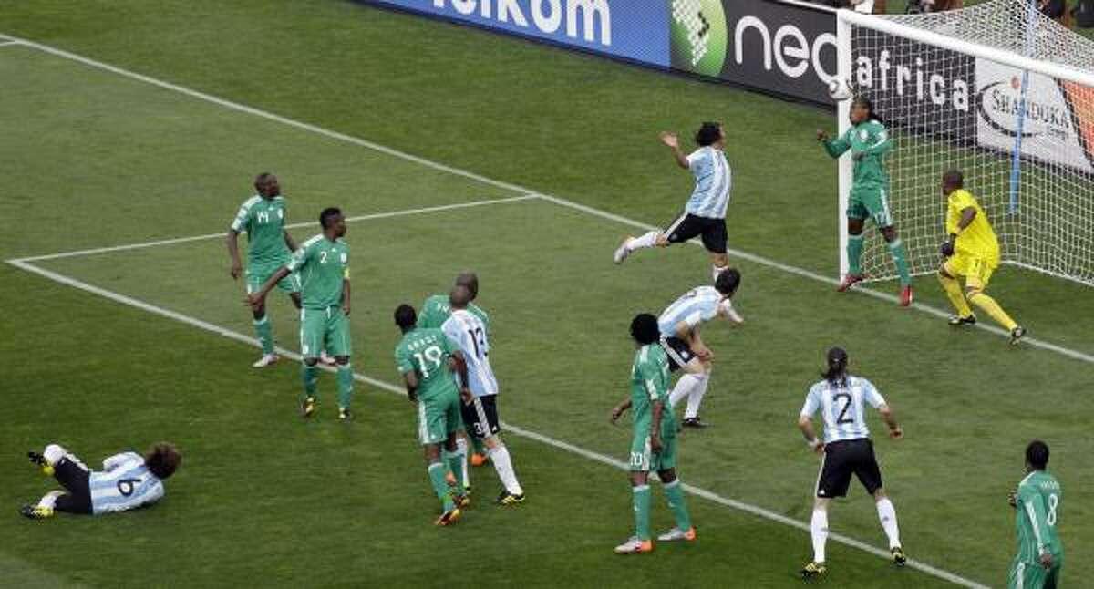 Argentina's Gabriel Heinze, bottom left, scores on a header just six minutes into that match at Ellis Park Stadium in Johannesburg.