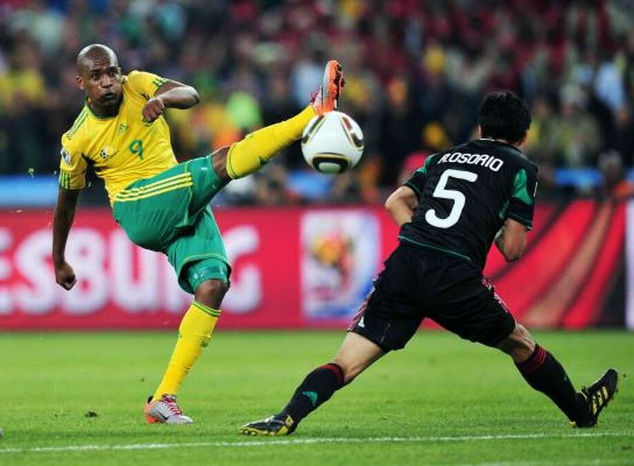 Katlego Mphela of South Africa in action against Carlos Osorio. Photo: Clive Mason, Getty Images