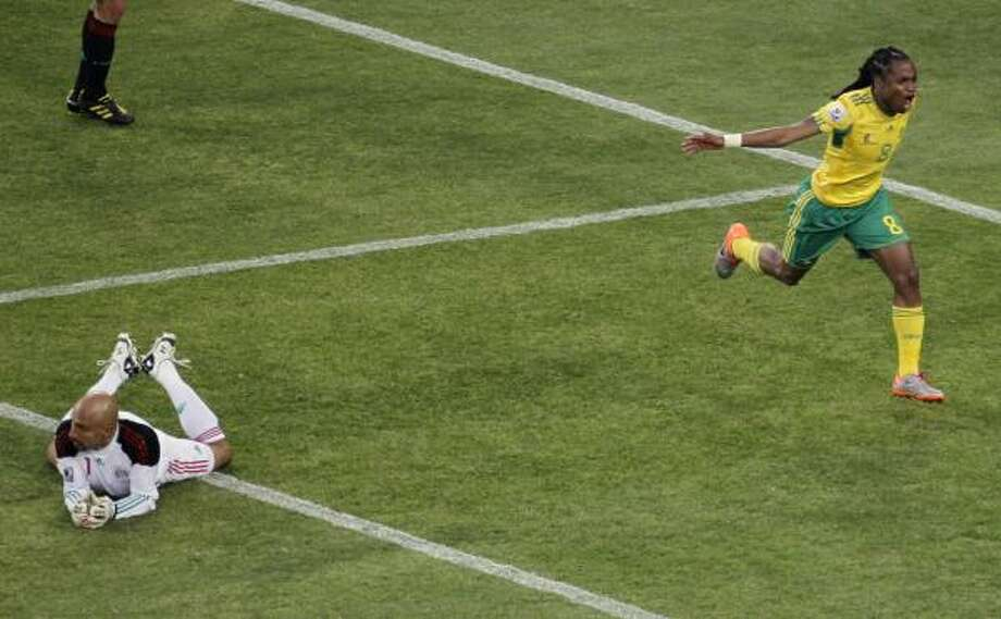 Mexico goalkeeper Oscar Perez had little chance against South Africa's Siphiwe Tshabalala on the goal. Photo: Marcio  Sanchez, AP