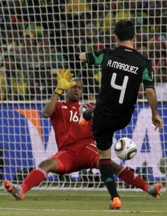 Mexico's Rafael Marquez, right, scores against goalkeeper Itumeleng Khune. Photo: Guillermo Arias, AP
