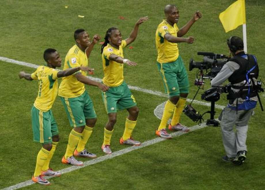 South Africa's Siphiwe Tshabalala, third from left, celebrates with fellow team members after scoring. Photo: Luca Bruno, AP