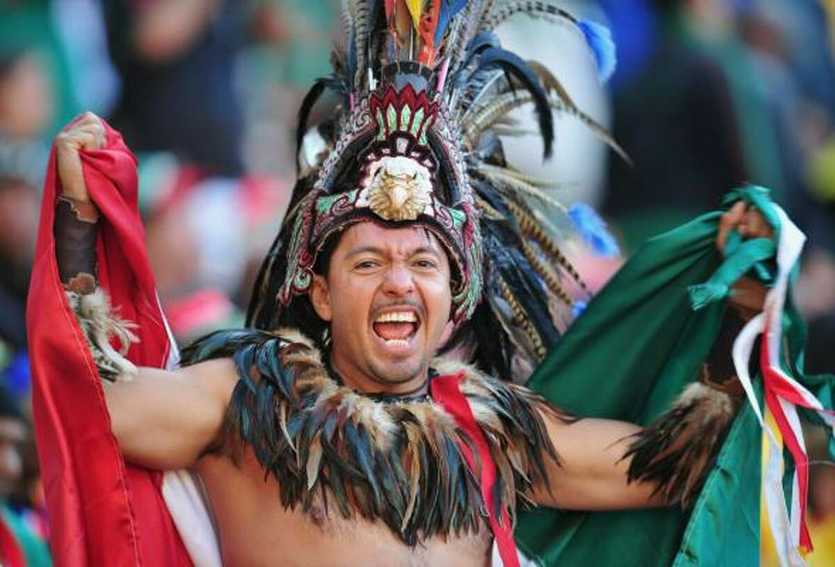 A Mexican fan enjoys the atmosphere at the Opening Ceremony at Soccer City Stadium.