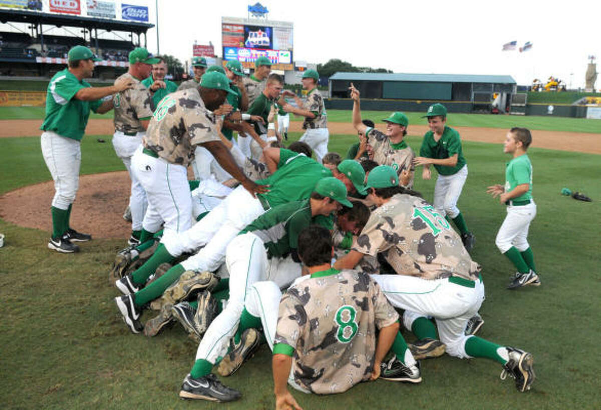 Brenham celebrate their 2-1 win over Corpus Christi Calallen to take the Class 4A state championship at Dell Diamond in Round Rock on Thursday.