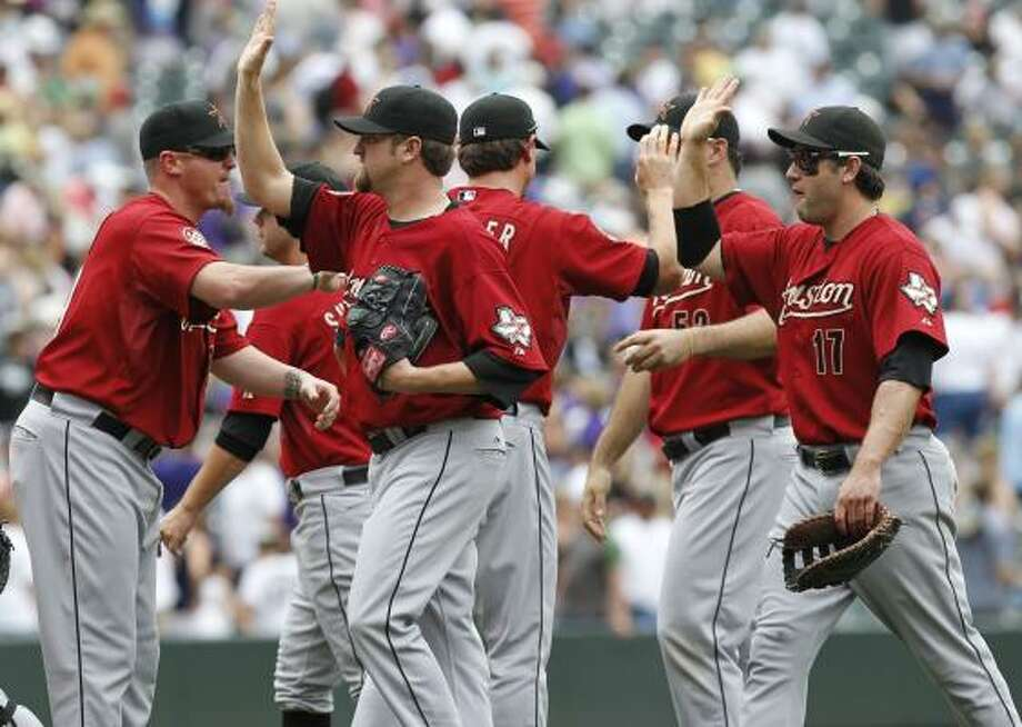 June 10: Astros 5, Rockies 4Astros' players celebrate after defeating the Rockies in the series finale, 5-4. Photo: Ed Andrieski, AP