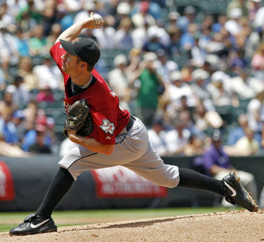 Astros starting pitcher Roy Oswalt threw nine strikeouts, tying a season-high against the Rockies. Photo: Ed Andrieski, AP