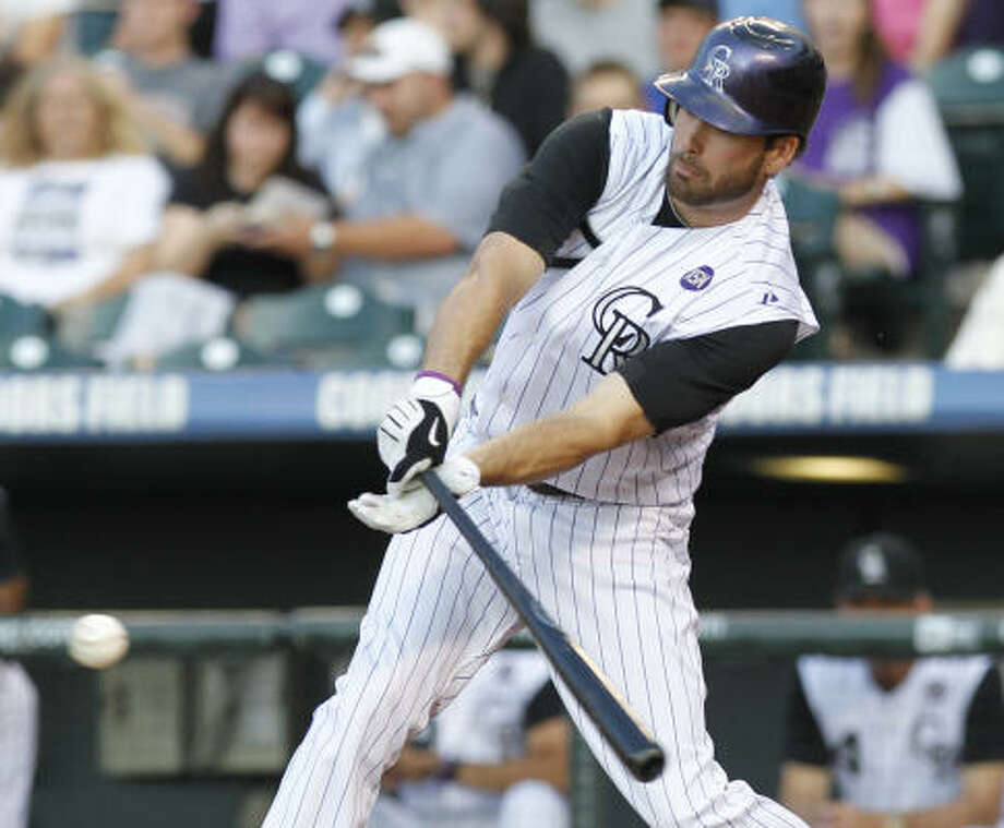 Rockies left fielder Seth Smith hits an RBI single in the second inning. Photo: Ed Andrieski, AP