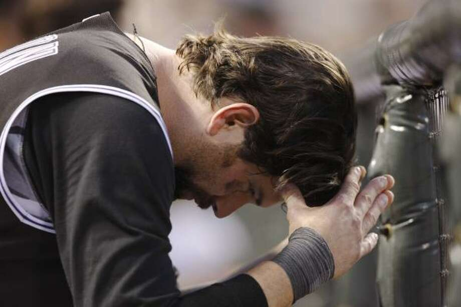 Rockies first baseman Todd Helton sits in the dugout after striking out in the sixth inning. Photo: David Zalubowski, AP