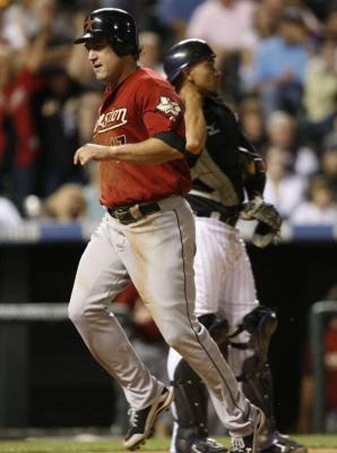 Astros first baseman Lance Berkman crosses home plate to score Carlos Lee's single. Photo: David Zalubowski, AP