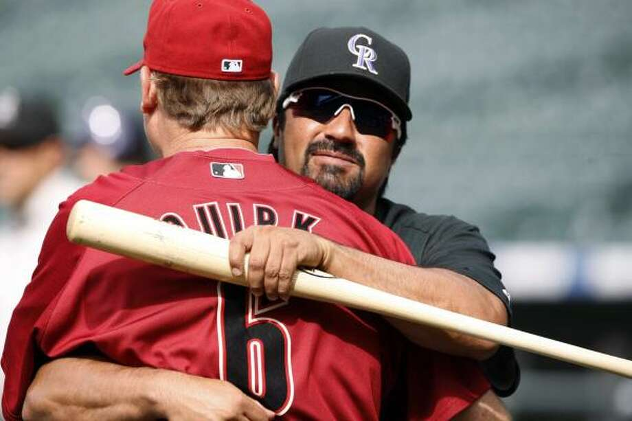 June 7: Rockies 5, Astros 1Rockies coach Vinny Castilla, right, greets Astros bullpen coach Jamie Quirk before the first inning. Quirk served with Castilla on the Rockies' coaching staff before leaving several seasons ago. Photo: David Zalubowski, AP