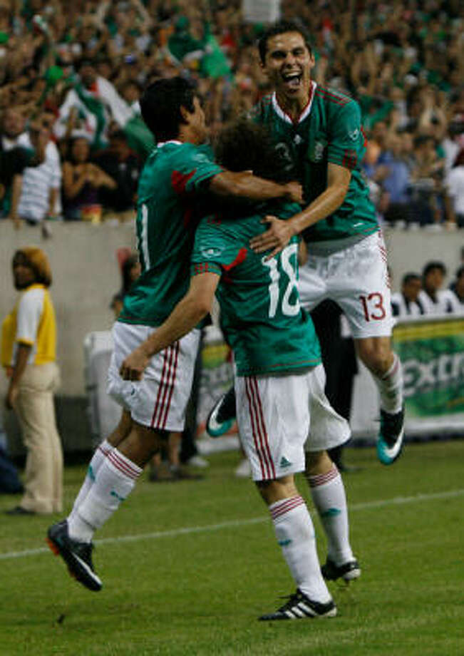 Reliant Stadium was filled as 70,099 watched Mexico face Angola in a friendly on Thursday. Photo: Julio Cortez, Chronicle