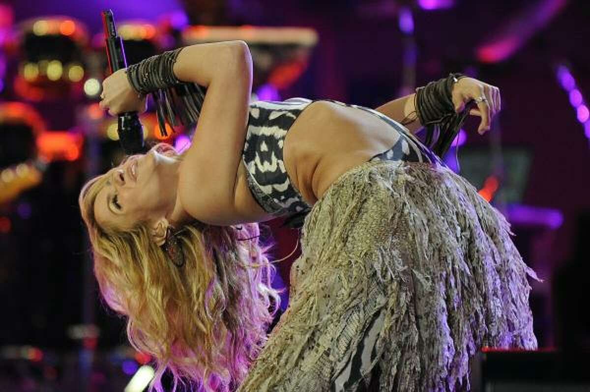 Colombian singer Shakira performs on stage.
