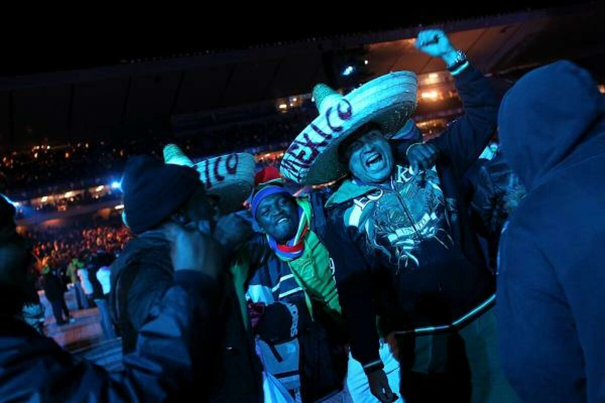 Mexican and South African soccer fans cheer at the World Cup Launch Concert.