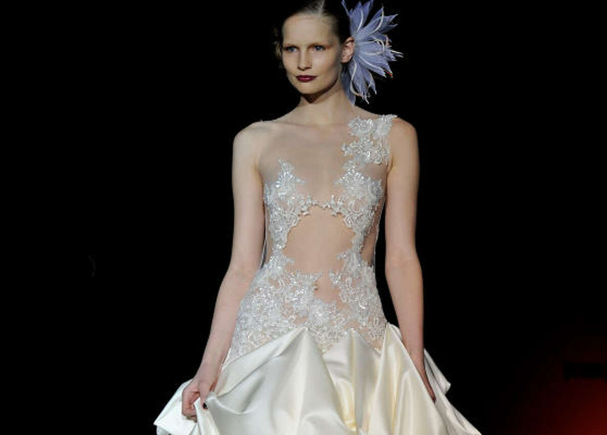 White satin, silk and lace graced the fashion week spring and fall runways all over the world, giving brides-to-be a taste of the hottest in bridal trends from top designers.