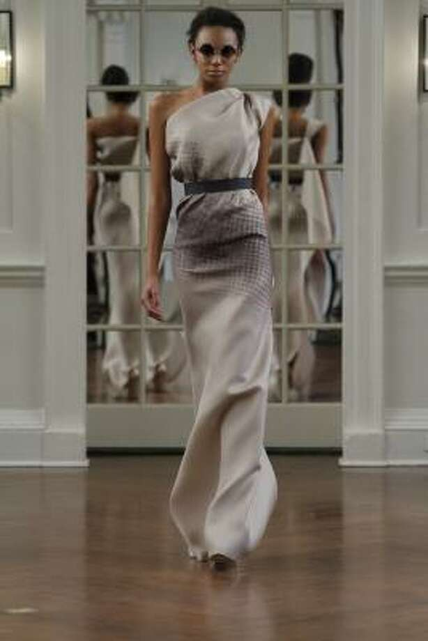 This dress by Victoria Beckham proves that draped, yet fitting, designs will be a hit in 2010. Photo: Dan Lecca, AP
