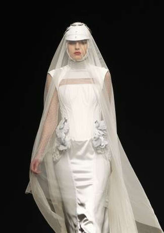 This dress may push boundaries, but this design cues brides that long veils will be in-style this year. Photo: Victor R. Caivano, AP