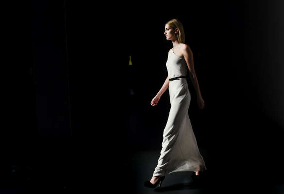 White elegant fabrics with belted waists are popular on the runway. Photo: Daniel Ochoa De Olza, AP