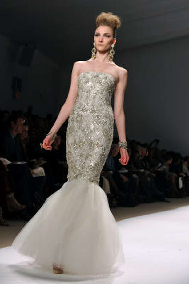 Naeem Khan's mermaid-style shows off curves and guarantees that a bride in this gown will be the center of attention. Photo: Diane Bondareff, AP